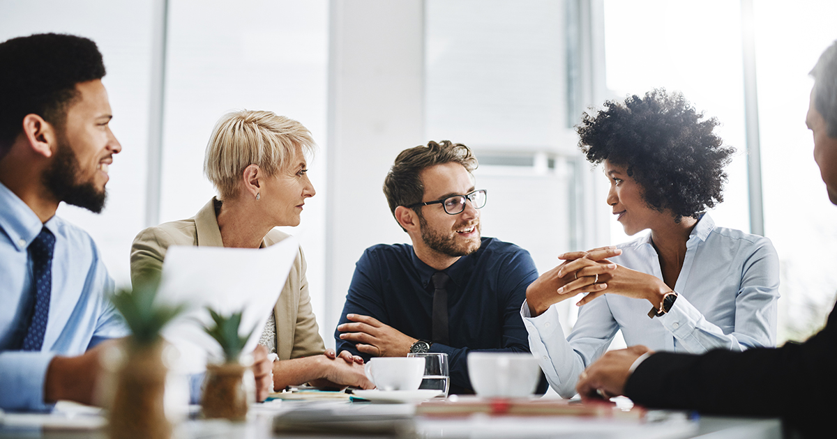 diverse-employees-talking-1200x630