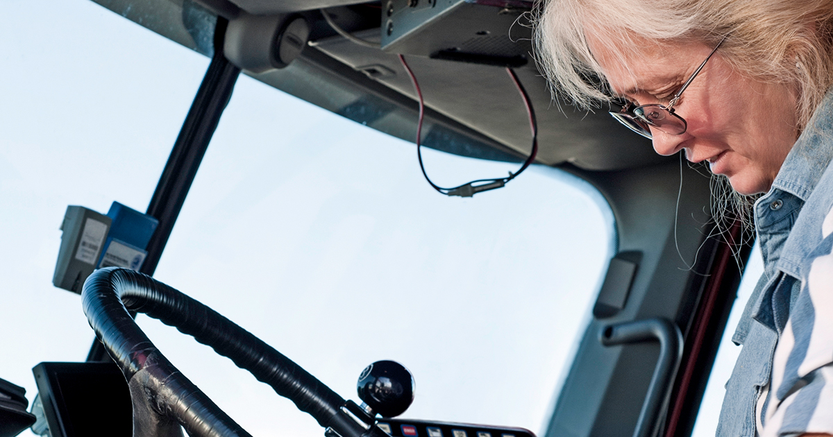 female-driver-looking-down-1200x630