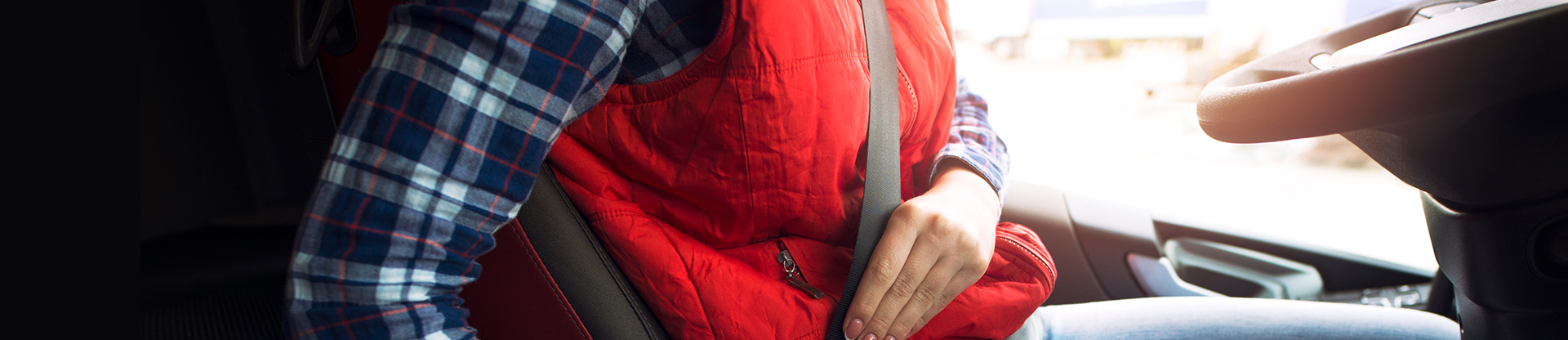 woman-buckling-seatbelt-1920