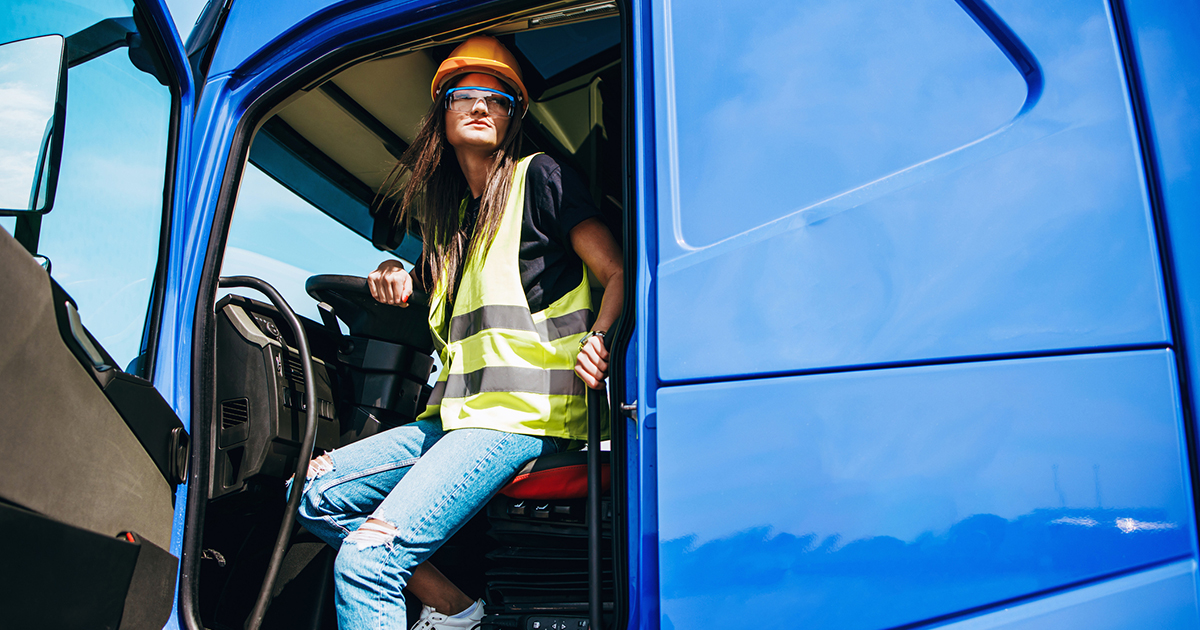 young-female-driver-blue-truck-1200x630